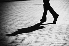 A stranger passing by... (manganite) Tags: street shadow people bw berlin men topf25 silhouette digital germany walking geotagged interestingness google cool nikon europe dof legs tl candid perspective guys streetscene stranger explore backside d200 nikkor dslr noise noisy pariserplatz interestingness67 i500 18200mmf3556 utatafeature manganite nikonstunninggallery 25faves ipernity challengeyou challengeyouwinner artlibre diamondclassphotographer flickrdiamond date:year=2007 flickrphotoaward geo:lat=52516524 geo:lon=1337932 date:month=april date:day=12 stadtgetty2010