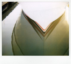 golden light (lawatt) Tags: sunlight film water marina polaroid evening boat marincounty spectra 990