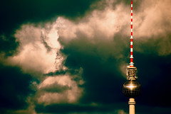 TV tower V (manganite) Tags: windows sky sunlight reflection berlin topf25 clouds digital buildings germany geotagged interestingness topf50 nikon colorful europe cross cloudy tl towers dramatic atmosphere explore alexanderplatz d200 nikkor dslr mitte televisiontower tvtowers interestingness23 i500 18200mmf3556 utatafeature manganite nikonstunninggallery 25faves ipernity abigfave colorphotoaward impressedbeauty date:year=2007 flickrphotoaward geo:lat=52509691 geo:lon=13377442 tvtowerset date:month=april date:day=6 stadtgetty2010