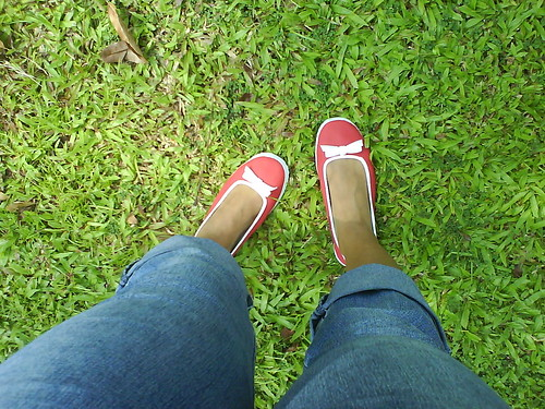 of red shoes and green grass