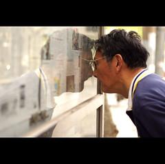 Time for new glasses. (chris spira) Tags: china man reading glasses newspaper shanghai chinese short eyesight