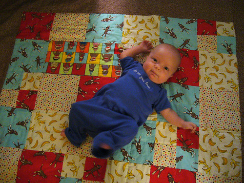 Max tries out his new quilt