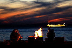 On the beach at night (helpcraft) Tags: seattle sunset beach water ferry night fire boat washington nightshot romance explore pacificnorthwest alkibeach pugetsound atnight ferryboat blueribbonwinner d40 cotcmostinteresting flickrsbest wst2007poi