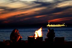 On the beach at night (helpcraft) Tags: seattle sunset beach water ferry night fire boat washington nightshot romance explore pacificnorthwest alkibeach pugetsound atnight ferryboat blueribbonwinner d40 cotcmostinteresting flickrsbest wst2007poi
