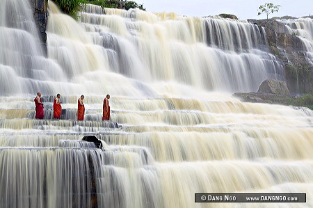 Amazing Grace - Buddhist monks chant at Pongour Falls, the largest waterfall in Dalat, Vietnam. / Dang Ngo