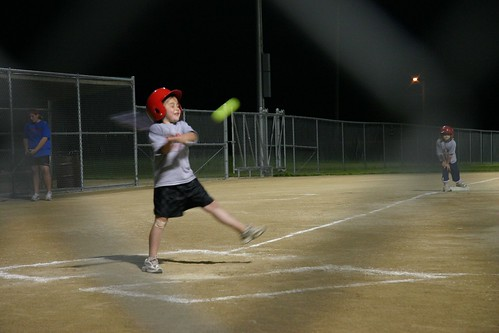 Izzy playing softball