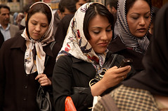 Pavement Texting (kamshots) Tags: girls woman scarf iran head grand bazaar tehran texting hejab kamshots