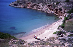 'My Own Beach', Ios, Greece (Trig's) Tags: world travel summer beach water sunshine boats island islands boat sand europe waves stones tan hellas adventure greece backpack beaches suntan summerfun ios cyclades sunscreen secluded sunworship iosisland iosgeece