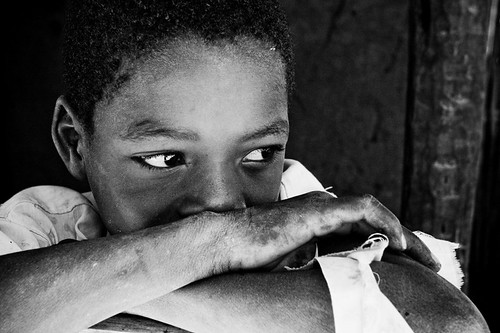A boy casts his eyes off into the distance in N. Mozambique. ph: Esther Havens