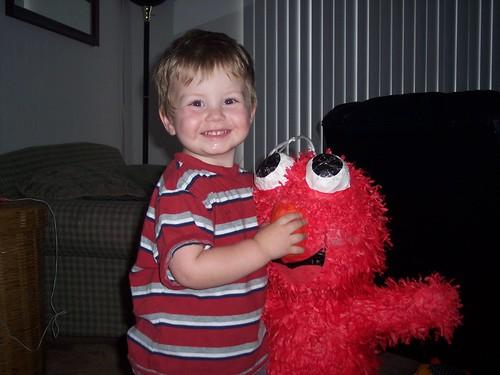 Nathan and his Elmo Piñata