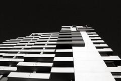 baukastenprinzip (Lunochod) Tags: sky blackandwhite bw building monochrome architecture contrast pattern balkon highcontrast modular repetition highrise balconies schwarzweiss muster hochhaus frth digikam modulardesign baukasten baukastenprinzip