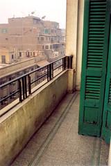 Cairo (Peter Gutierrez) Tags: africa city morning urban sun building dusty film sunrise buildings dawn town photo sand terrace african balcony sandy egypt peter cairo egyptian balconies gutierrez dust tarraces petergutierrez