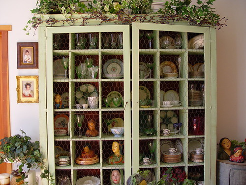 Large pale green cabinet storing a large collection of china, via Flickr: Jacquiscloset
