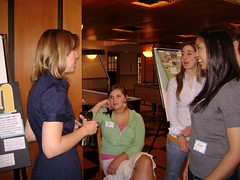 Symposium executive director Caroline Smith discusses the work of presenters Laura Maas, Alexa Blanco, and Kat Medida. 2007 University Writing and Research Symposium. The George Washington University. Saturday, April 21