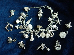 charms, attached or not (Jacqi B) Tags: lighthouse house bird silver bure boot pig swan ship dragon cross heart mask theatre turtle shell moose pixie jewellery chain r anchor elk viking charms imp angelfish rollingpin 2007 saucepan wagtail stchristopher silverfern adze chefshat dolphon lincolnimp tragedyandcomedy diskofphaistos fatihhopeandcharity