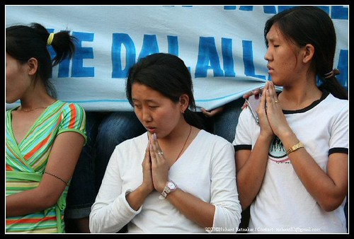 The youth join the monks in their prayer for peace