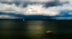 into the storm (wildpianist) Tags: ocean seattle park sky panorama storm reflection texture nature water rock skyline clouds sailboat canon eos boat washington sailing pacific northwest horizon dramatic pacificnorthwest sail pugetsound viewpoint discoverypark 30d sigma1850mmf3556dc christarnawski