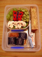 Bento with a butterfly (evilibby) Tags: kitchen gum bread lunch mushrooms beans rice chocolate grapes biscuits bento nori