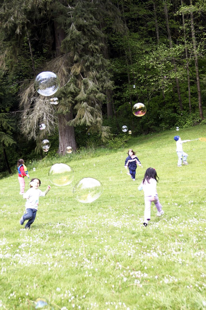 Kids chasing bubbles