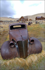 A Car Grazing in Bodie (shadowplay) Tags: california cars rust ghosttown lawnmower bodie 12mm grazing carwithmoustache