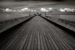 Clevedon Pier (Nigel Dourley) Tags: wood old uk sea england blackandwhite bw cloud white black water canon bristol coast pier wooden seaside europe perspective sigma somerset historic top20 planks theeye clevedon blueribbonwinner 1770mm 35faves scoremebw43 400d abigfave superaplus aplusphoto superbmasterpiece diamondclassphotographer flickrdiamond blackribbonbeauty flickrphotoaward nigeldourley cornishphotographer youvegottheeye artlegacy