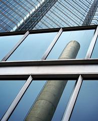Smokestack Reflection (room929) Tags: blue sky toronto reflection glass metal buildings panes smokestack