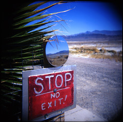 Desert Reflected (pixietart) Tags: california film nature sign mediumformat square mirror holga saturated desert reflect stop deathvalley lanscape hotsprings fujivelvia chickenjohnbustrip