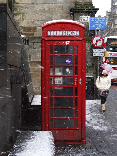 old phone box in the snow