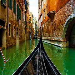 Orange + Green (Simple Dolphin) Tags: venice italy orange color green topf25 water topv111 canal topf50 topv555 topv333 explore gondola 1x1 supershot