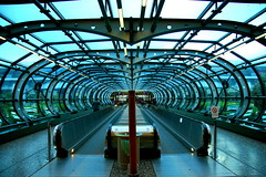city shooter (maybemaq) Tags: italy milan glass vanishingpoint airport pattern geometry milano tube corridor symmetry passage breathtaking airportexpress malpensa aplusphoto diamondclassphotographer betterthangood goldstaraward