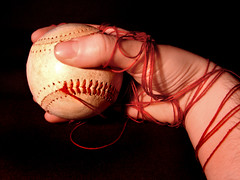 unravel (Boston Wolverine) Tags: red thread ball hand baseball wind stitches stitching seam hold undone unravel seams