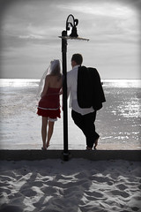 Just a Moment (Nicholaus Haskins) Tags: ocean red sun love beach water lamp psp happy groom bride sand couple curves marriage happiness lamppost moment marry levels reddress selectivecolor haskins nicholaus coupleinlove colorpop flickrplatinum loversonthebeach haskinsphotography coupleonthebeach nicholaushaskins