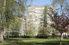 Florin Court across Charterhouse Square (FrMark) Tags: park city uk trees windows fiction england building london art grass mystery architecture century square design tv thirties apartments britain location barbican moderne flats gb murder novel british artdeco c20 curved deco whitehaven 20th streamline poirot detective mansions agathachristie charterhouse twentieth