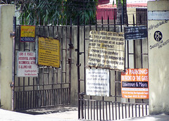 Gate with signboards