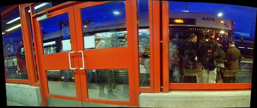 People boarding an OC Transpo New Flyer Invero bus...