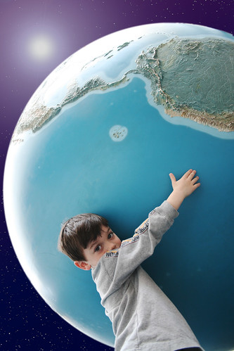 Photo of a young boy hugging the Earth