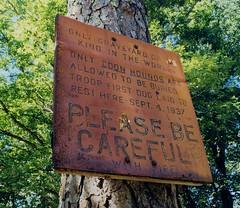Coon Dog Graveyard (MilkaWay) Tags: graveyard sign rural alabama hound rusty coon