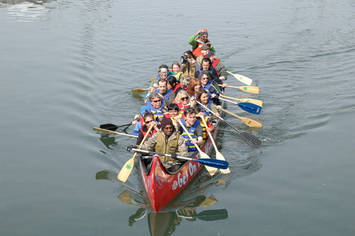 canoes full of people