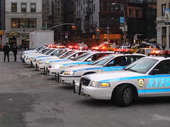 Row Of Police Cars With Flashing Lights