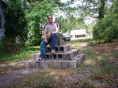 Luca Masters sitting atop his cinderblock pyramid.