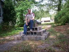 Luca Masters sitting atop his cinderblock pyramid.