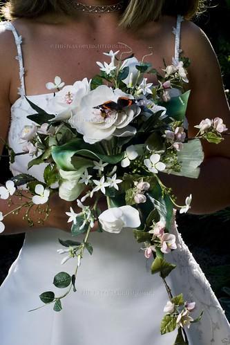 Bride, flowers & butterfly