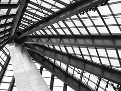 Cobweb Ceiling (Carl_C) Tags: light sky blackandwhite building glass lines museum architecture virginia geometry shapes ceiling abstructure glassceiling architecturalphotography geometricshapes contemporaryarchitecture negroyblanco princewilliamcounty lamplights urbanpatterns nationalmuseumofthemarinecorps borderingperception usmarinemuseum