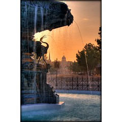 Watery Sunrise (sunsurfr) Tags: orange water fountain sunrise downtown capital alabama roundabout structure explore montgomery d200 hdr courtsquare nikonstunninggallery anawesomeshot colorphotoaward explorecover courtsquarefountain sunsurfr