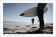 Surfers (~* Rae Rae *~) Tags: ocean copyright beach sand surf waves harbour secret board surfers desaturated legrope raethrenoworthphotography blueelementphotography raethrenoworth blueelement