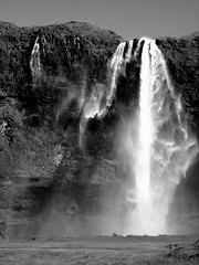 Wind and Water (little_frank) Tags: world trip travel wild vacation bw panorama cliff white black nature water beautiful beauty rock vertical wonderful river wonder island freedom waterfall iceland islandia amazing scenery europe heaven paradise day power view place natural wind north dream dramatic rocky surreal peaceful windy natura falls falling stunning scenario dreamy nordic wilderness marvel northern foss viaggi viaggio breathtaking impressive vacanza seljalandsfoss paesaggio vacanze islande marvellous spectacle breathless unspoiled cascata islanda seljalandfoss primordial ìsland islandese seljalandsá diamondclassphotographer flickrdiamond