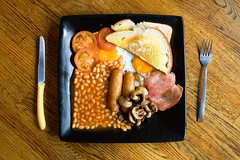 what puts the great in great britain (lomokev) Tags: wood greatbritain england food english breakfast canon table mushrooms eos bacon cafe beans madera tea britain eating fucking egg knife plate fork full eat sausages 5d holz bakedbeans fryup cutlery opposition fullenglish breaky canoneos5d oppositioncafe file:name=img1154 rota:type=showall rota:type=stilllife use:on=moo ξυλο top10brighton fullfuckingenglish use:on=alamy yahoo:yourpictures=bestofbritish