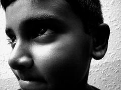 Let me guess... (Ashwa Faheem ( avva )) Tags: light white black closeup photography child emotion sony avva