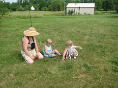 Kathi teaches the girls about popping weeds