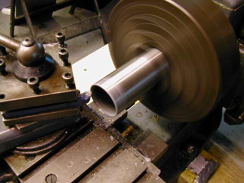 image of head-tube being faced in the lathe